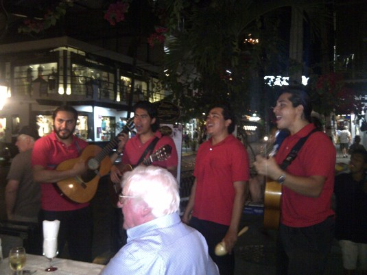 Los Bambinos singing to folks at a restaurant on Olas Altas.
