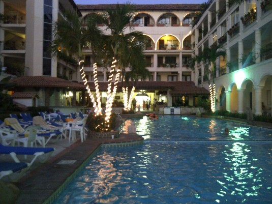 Pool area at night from ocean side